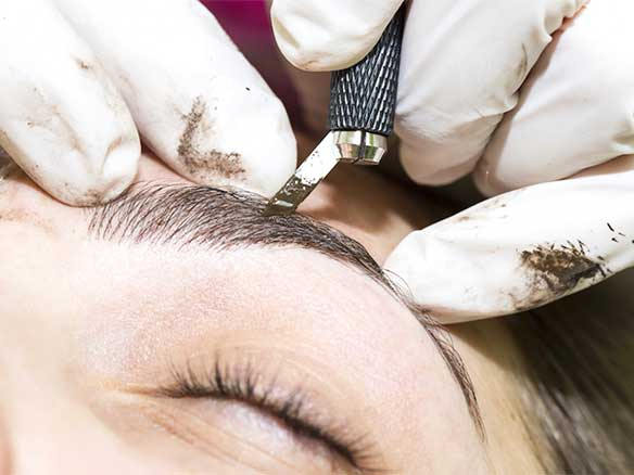 microblading knife in hand